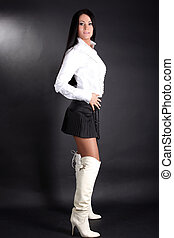 fashion young woman in white shirt and black skirt