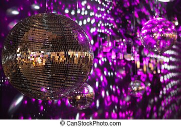 Shiny disco balls in a nightclub