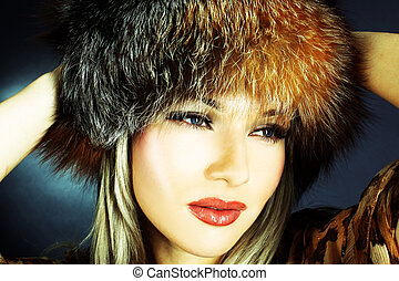 lovely young woman in winter fur hat