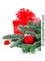red Christmas ball with pine branch, gift and snow, isolated...
