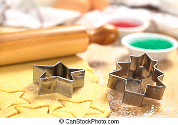 Baking Christmas Cookies: Cookie cutter on rolled out sugar...