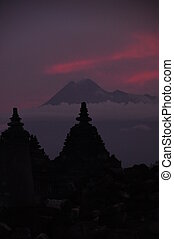 Ancient Temple - Active Volcano - Silhouette Of Ancient...