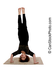Head Stander - Elementary child standing on her head in her...