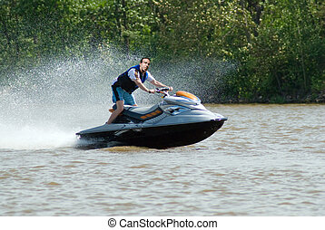 Jetski - A young man riding a jetski on the river