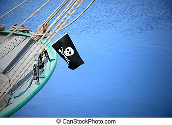 A pirate flag (Jolly Roger) on  sailing  ship
