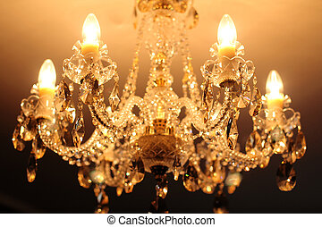 Luxury vintage crystal chandelier on a ceiling in apartment...
