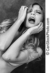 scream - young topless female cry black and white