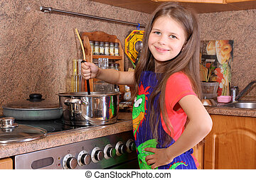 girl cooking dinner in the kitchen