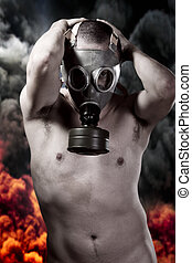 Nude man with gas mask over explosion background