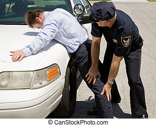 Traffic Stop - Pat Down - Police officer patting down a...