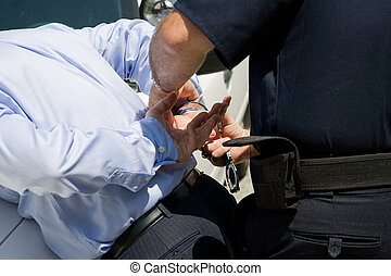 White Collar Crime - Closeup view of a police officer...