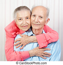 Closeup portrait of a smiling elderly couple
