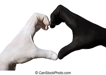 Heart formed by black and white hand