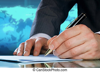 Businessman's hand with a pen. International business...