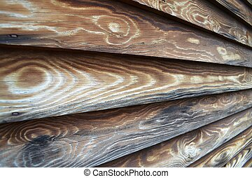 Close-Up of Rough Wood Siding - Detail of hand-hewn wood...