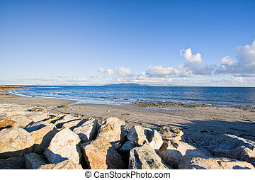Galway Bay in Ireland. The Burren can be seen in the...