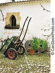 Old wagon in a court yard Mallorca Spain
