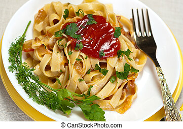 Flat macaroni with ketchup and greens - Flat long macaroni...