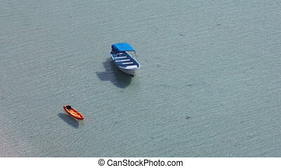 Kayak and a Boat Along the Ocean Be