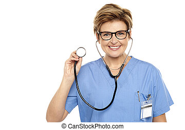 Senior female physician ready to examine you. All on white...