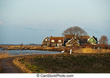 Dutch Landscape - Fishermens cottages along the Dutch dike...