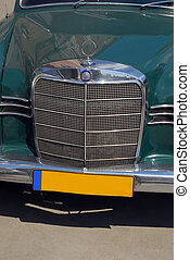 Old-timer car - An old German car. Green color and chrome...