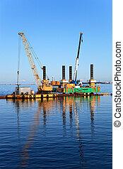 Floating dredging platform