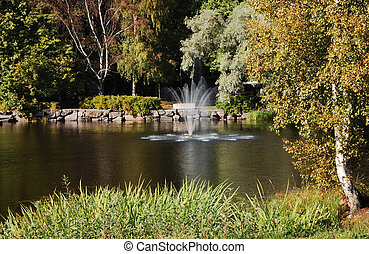 Fountain amidst the lake in a park