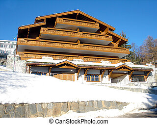 Ski Chalet in winter - Exterior architecture of Swiss Ski...
