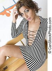 Graffiti fashion model sitting - Portrait of a twenty...