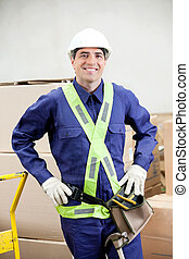 Confident Foreman In Protective Clothing Standing At...