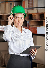 Confident Female Supervisor With Digital tablet At Warehouse