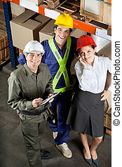 Portrait of Happy Foreman With Supervisors - High angle...