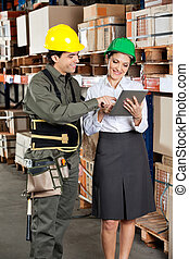 Supervisor And Foreman Using Digital Tablet at Warehouse -...