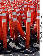 Road Warning Cones - Pile of orange or red caution cones...