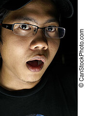 Frightened asian male portrait