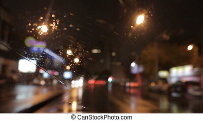 car window rain night background defocused in motion time...