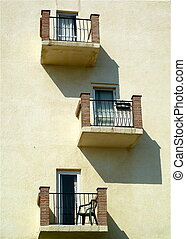 Balconies - A building with Three balconies