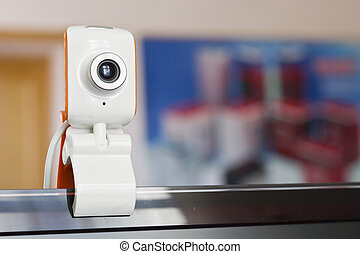 Small webcam - The small webcam hangs on the monitor