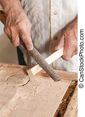 Rasp - Carpenter working with a traditional rasp tool