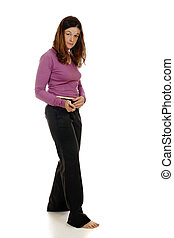 Getting Dressed - Woman buckling her belt as she gets...