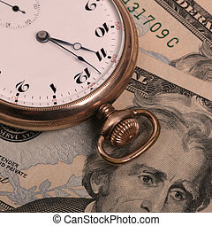 Time is Money - Old Style Pocket Watch on top of US Currency