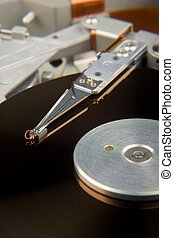 Hard Drive Exposed - Macro view of the inner workings of a...