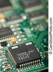 Microchip On Circuit Board - Close-up of a microchip...
