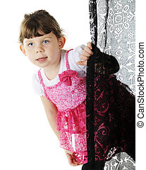 Peek Around the Curtain - An adorable preschooler dressed in...