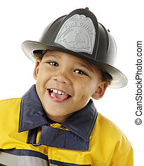 Tiny Fire Fighter - Close-up portrait of an adorable...