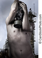 Man in a gas mask looking , industry at background