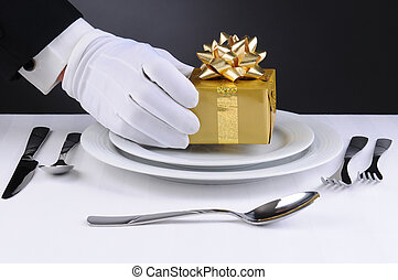 Waiter Setting Present on Plate - Closeup of a waiters...