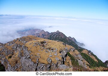 clouds around the top of mountain - clouds around the top of...