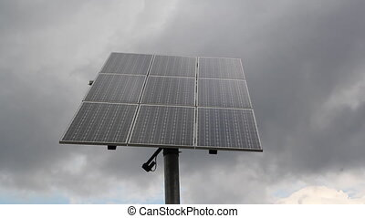 Solar Panel. Cloudy timelapse. - Dark clouds move behind a...